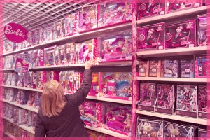 A customer looks at the doll section in the Village of Paris JoueClub toy shop during the holiday season in Paris